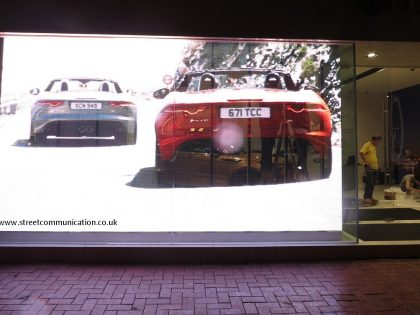 Transparent LED screen display on glass: LAND Rover showroom