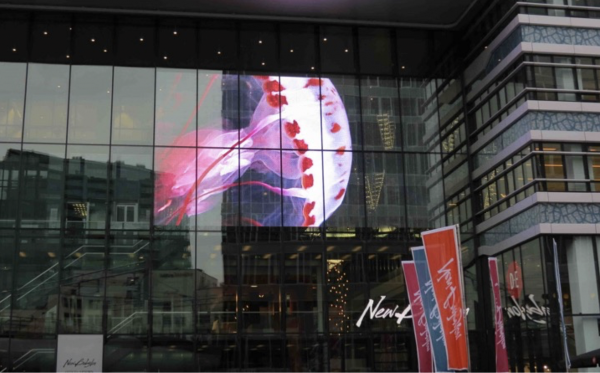 transparent-led-curtain-screen-display-on-window-newbabylon-nl