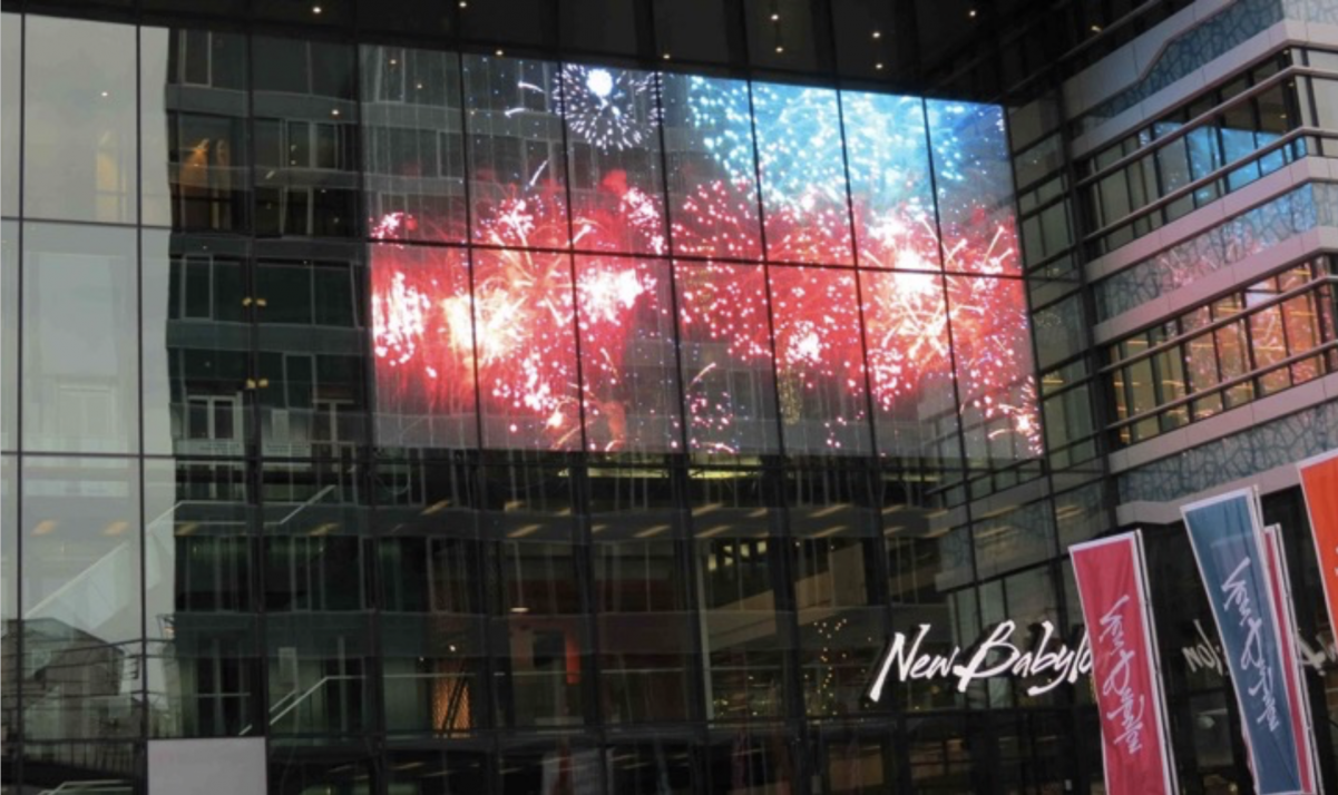 transparent-led-display-curtain-secreen-on-window-newbabylon-nl